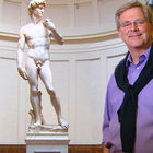 Rick Steves stands in front of David